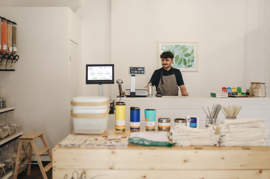 Man behind the counter at a small business