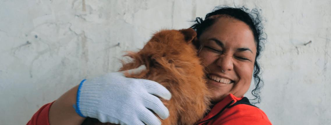 Vet hugging a dog