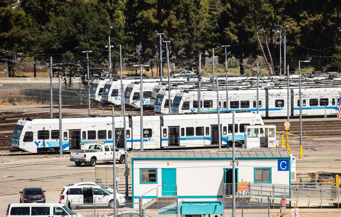 several Valley Transportation Authority (VTA) light rail trains in a yard